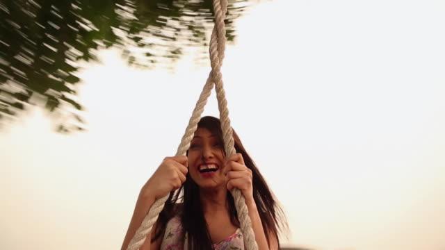 Young woman enjoying rope swing, Haryana, India