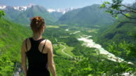 Young woman enjoying the view at a mountain valley