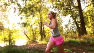 Young woman exercising and trail running