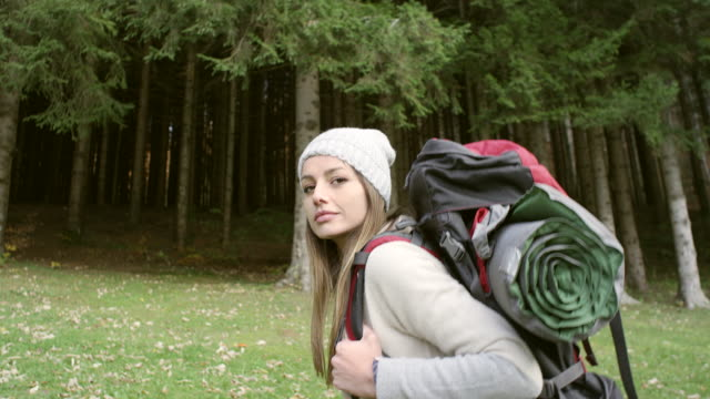 Young woman exploring the forest