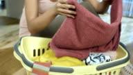 HD: Young Woman Folding Laundry
