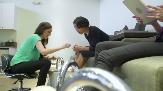 Young woman getting a pedicure in a spa