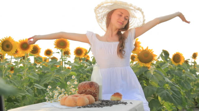 Young woman having breakfast on nature
