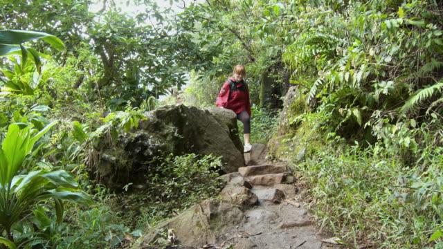MS Young woman hiking on Kalalau Trail, Kauai, Hawaii, USA