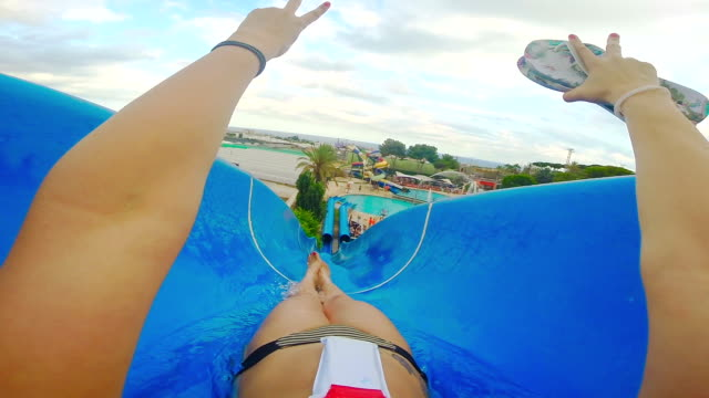 POV young woman in a waterslide having fun