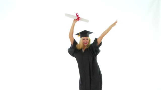 Young woman in graduation gown holding diploma