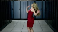 MS DS Young woman in red dress dancing in server room