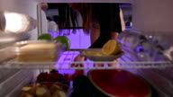 Young woman in underwear takes cake from the fridge