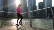 WS Young woman jogging in place in the city.