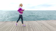 Young woman Jogging next to the sea
