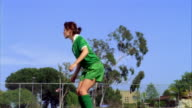 SLO MO, MS, Young woman kicking soccer ball and falling on field, Biola University, La Mirada, California, USA