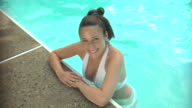CU, HA, Young woman leaning at edge of swimming pool, portrait, Middlesex, New Jersey, USA