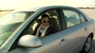 DS, CU, Young woman learning to drive on parking lot, Jones Beach, New York, USA