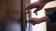 Young woman locking the door close up.
