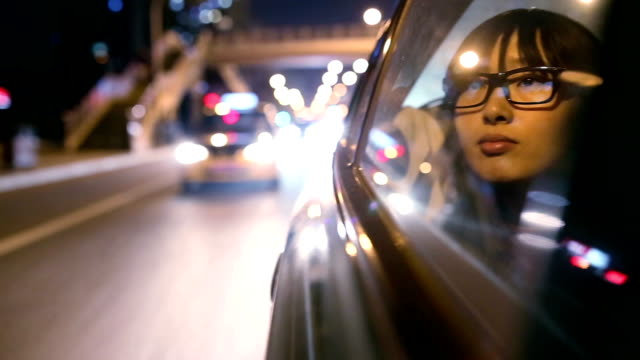 Young woman looking outside in car