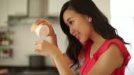 TU TD Young woman making cupcakes at home.