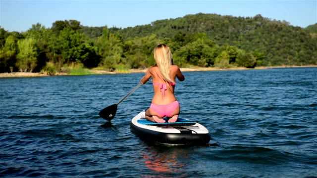 Young woman paddle borading