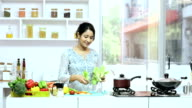 MS PAN Young woman preparing food in kitchen