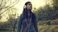 Young woman relaxing and listening music in outdoor.