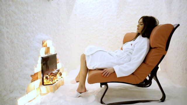 Young woman relaxing in the salt room (HD)