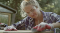 Young woman renovating old furniture