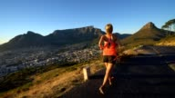 Young woman running at sunrise, Cape Town, South Africa