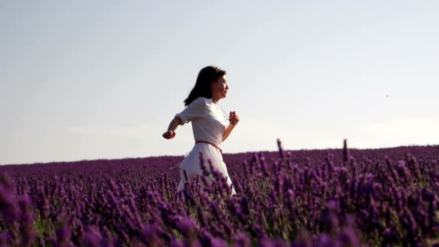 Young woman running in lavender field