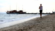 Young woman running on a beach