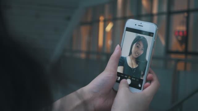 Young woman selfie using selfie