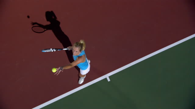 SLO MO, WS, HA, Young woman serving tennis ball, Santa Barbara, California, USA