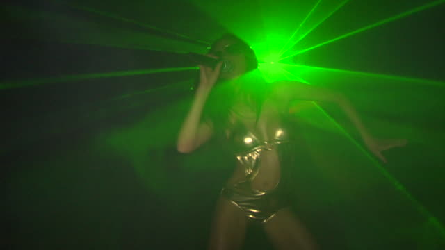SLO MO, MS, Young woman singing and dancing in nightclub, London, England