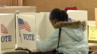 MS, Young woman sitting at voting booth, Toledo, Ohio, USA