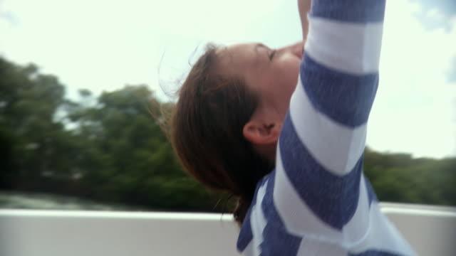 CU POV Young woman sitting in speed boat / Scarborough, Tobago, Trinidad And Tobago