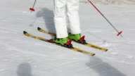 Young woman skiing on ski slope