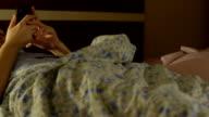 young woman sleep and play phone