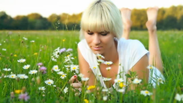 HD DOLLY: Young Woman Smelling Daisies