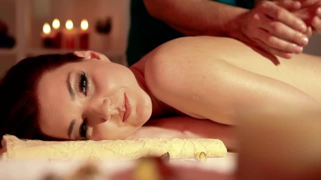 Young woman smileing and enjoying massage