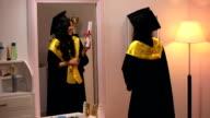 Young woman standing near mirror, Delhi, India