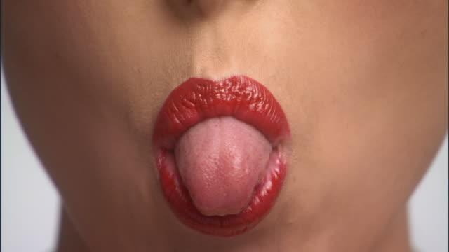 SLO MO, ECU, Young woman sticking out tongue