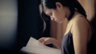 Young woman studying notes and doing preparations for exams.