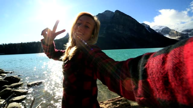 Young woman takes selfie at Lake Louise