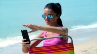 CU Young woman taking a selfie on the beach