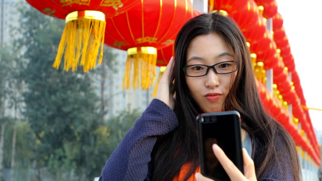 Young woman taking a selfie with mobile phone