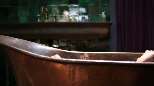 MS Young woman taking bath in bath tub