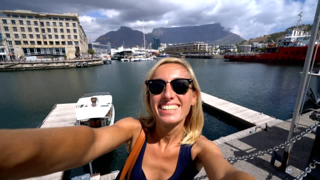 Young woman taking selfie portrait in Cape Town, South Africa