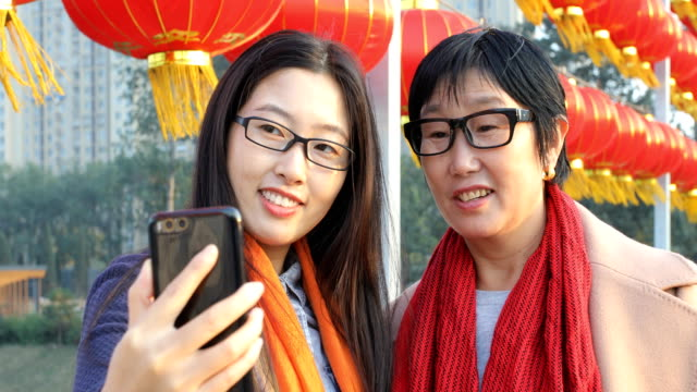 Young woman taking selfie with mom