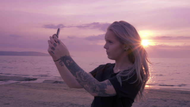 Young Woman taking Selfies on Beach