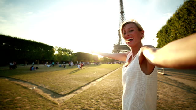 Young woman talking a selfie at the Eiffel tower