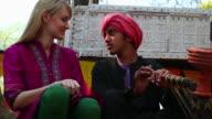 Young woman talking with a indian boy, Suraj Kund, Faridabad, Haryana, India