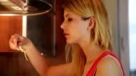 young woman tasting spaghetti